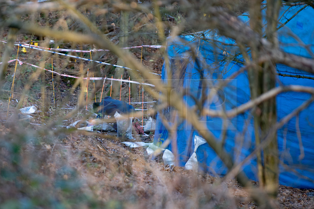 """© Licensed to London News Pictures. 09/12/2019. Gerrards Cross, UK. A police officer conducts a finger tip search of ground in woodland as the Metropolitan Police Service continues a search operation in Gerrards Cross, Buckinghamshire. Police have been in the area conducting operations on Hedgerley Lane since Thursday 5th December 2019. In a press statement issued on 7th December a Metropolitan Police spokesperson said """"Officers are currently in the Gerrards Cross area of Buckinghamshire as part of an ongoing investigation.<br /> """"We are not prepared to discuss further for operational reasons."""" No further updates have been issued. Photo credit: Peter Manning/LNP"""