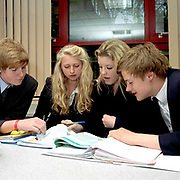 Teenage pupils studying during a lesson at Ampleforth College, North Yorkshire, UK. Ampleforth College is a coeducational independent day and boarding school in the village of Ampleforth, North Yorkshire, England. It opened in 1802 as a boys' school, and is run by the Benedictine monks and lay staff of Ampleforth Abbey.