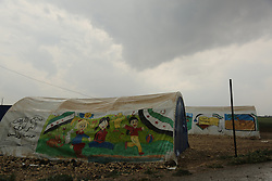 """May 3, 2017 - The """"Tilal As-Sham"""" camp is one of the camps for internally displaced people and is located north of the Syrian city of Azaz. Although the camp offers extremely limited resources to its residents, its most colourful tents  are being used as a school for the children of the camp.  Azaz is a city located in the Aleppo countryside, near the border with Turkey (Credit Image: © Juma Muhammad/ImagesLive via ZUMA Wire)"""
