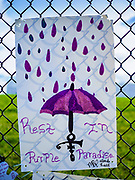21 APRIL 2017 - CHANHASSEN, MN: A homemade poster honoring Prince hanging on the fence in front of Paisley Park, the former home and recording studio of Prince. The superstar died from an accidental overdose of the opioid fentanyl on April 21, 2016. Friday was the first anniversary of his death. Crowds of people gathered at Paisley Park, which is now a museum, to honor the Minnesota born musician.     PHOTO BY JACK KURTZ