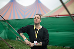 Jason Williamson of Sleaford Mods posing for photos backstage at the Pilton Palais cinema tent on Day 1 of the 2017 Glastonbury Festival at Worthy Farm in Somerset. Photo date: Friday, June 23, 2017. Photo credit should read: Richard Gray/EMPICS Entertainment
