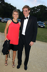 LUKE TOMLINSON and LOUISE MANN at the Cowdray Gold Cup Golden Jubilee Ball held at Cowdray Park Polo Club, on 21st July 2006.<br /><br />NON EXCLUSIVE - WORLD RIGHTS