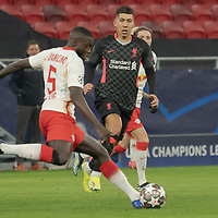 Dayot Upamecano (front) of RB Leipzig kicks the ball during the UEFA Champions League Round of 16 First Leg Football match between RB Leipzig and Liverpool FC in Budapest, Hungary on Feb. 16, 2021. ATTILA VOLGYI