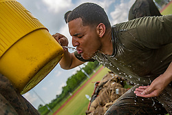 May 20, 2019 - Belle Chasse, Louisiana, U.S. - U.S. Marine Corps Cpl. Luis Alicea, a ground support equipment mechanic with Marine Aircraft Group 49, 4th Marine Aircraft Wing, Marine Forces Reserve, drinks water after a combat conditioning exercise at Naval Air Station Joint Reserve Base New Orleans on May 20, 2019. To increase readiness and to support the total force, Reserve and active Marines with MARFORRES participate in the Martial Arts Instructor Course. (Credit Image: ? U.S. Marines/ZUMA Wire/ZUMAPRESS.com)