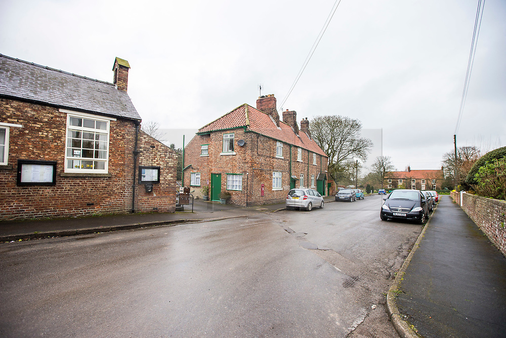 © Licensed to London News Pictures. 03/04/2016. West Heslerton UK. Picture shows Church Street in West Heslerton. The quintessential Yorkshire village of West Heslerton is up for sale at a price of £20M. The estate has a 21 bedroom historic hall, 43 houses, a pub, garage, church & playing fields. Former owner Miss Eve Dawnay died five years ago & she left a perfectly preserved village that has been untouched for 50 years. Her family are now selling the estate & hopefull of finding a buyer who will share Miss Dawnay's wish to conserve a bucolic way of life. Photo credit: Andrew McCaren/LNP