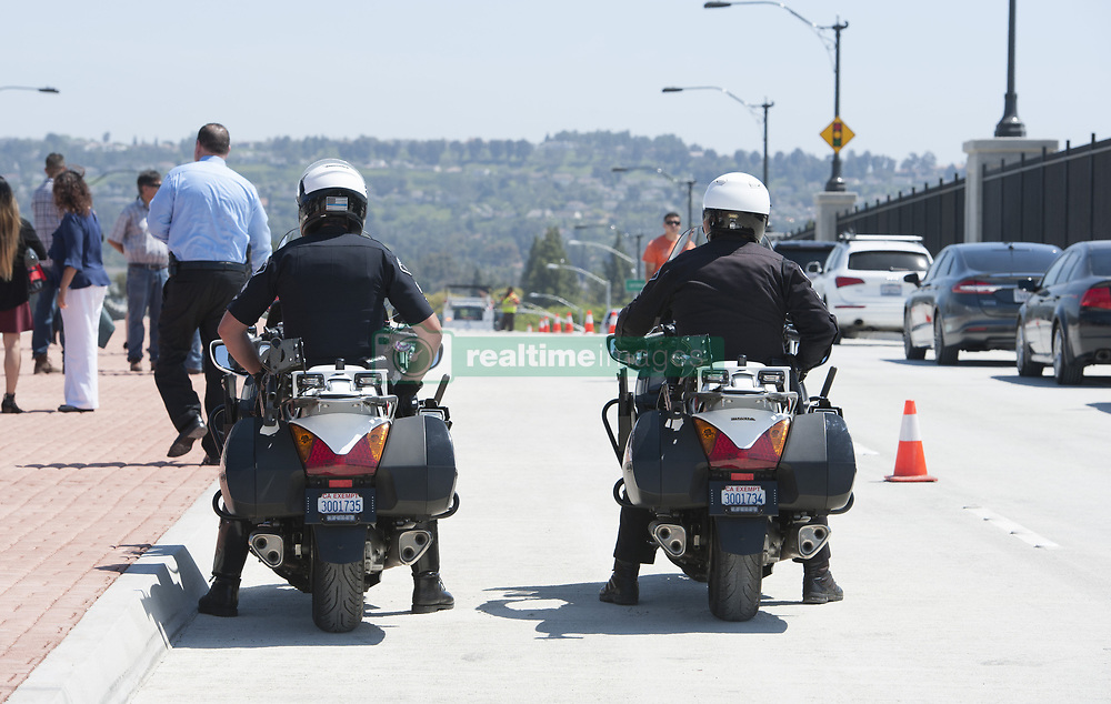 June 5, 2017 - Placentia, CA, USA - A pair of Placentia Police officers on motorcycles wait for the ribbon cutting ceremony to open the Lakeview Avenue bridge Monday. The OC Bridges project that built Lakeview Avenue over the Burlington Northern Santa Fe railroad line is the fifth of seven overcrossings and undercrossings planned by the Orange County Transportation Authority to improve the safety and commute of thousands of residents along the Orangethorpe Corridor in Anaheim, Fullerton, Placentia and Anaheim..in Placentia, CA on Monday, June  5, 2017. (Credit Image: © Sam Gangwer/The Orange County Register via ZUMA Wire)