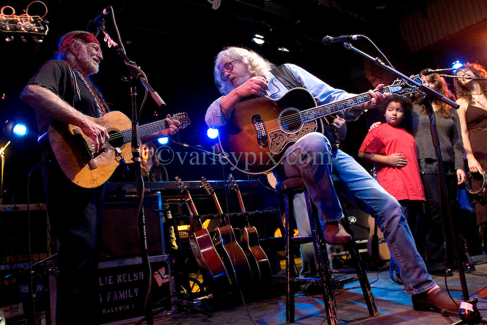 17 December, 05. Tipitina's, New Orleans, Louisiana.<br />  Arlo Guthrie and friends Riding on the city of New Orleans tour benefiting Musicares Hurricane relief 2005 sponsored by Amtrak. (rt) Arlo Guthrie and Willie Nelson (l) wrap up the last concert of the tour with friends on stage..<br /> Photo; ©Charlie Varley/varleypix.com
