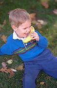 Preschooler age 5 talking on banana telephone.  St Paul  Minnesota USA