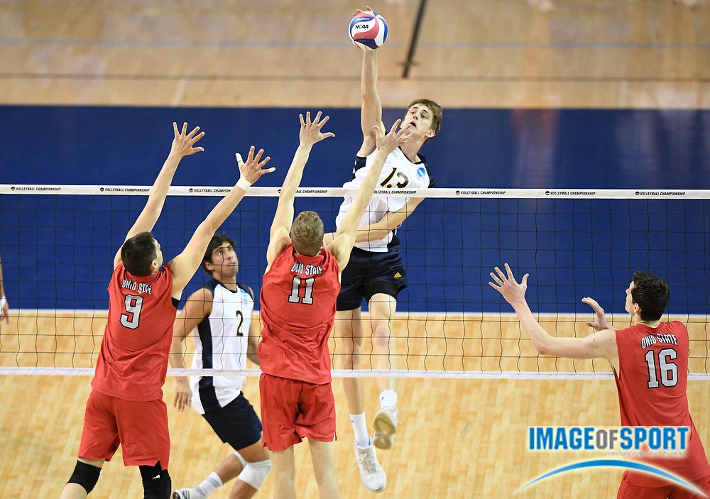UC Irvine Anteaters middle blocker Scott Stadick (13) spikes the ball as Ohio State Buckeyes outside hitter Nicolas Szerszen (9), middle blocker Blake Leeson (11) and opposite hitter Jake Hanes (16) defend during the opening round game of the NCAA college volleyball championship in Los Angeles, Tuesday, May 1, 2018. Ohio State defeated UC Irvine 25-19, 22-25, 25-23, 22-25, 16-14.