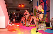 Kylie Minogue  surrounded  by models wearing her range of underwear, launch of Body Craze, Selfridges. Oxford St. 6 May 2003. © Copyright Photograph by Dafydd Jones 66 Stockwell Park Rd. London SW9 0DA Tel 020 7733 0108 www.dafjones.com