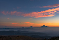 I stood on the slopes of Mount Hood with this view of 3 Cascade volcanoes to my north at sunrise. After days of smoke greatly limiting the views, it had finally settled into the valleys. Mt Adams is the closest peak on the right. Mt Rainier is the tallest in the middle, although it appears small because it's 100 miles away. Mt St Helens on the left stands out as the peak that's no longer symmetrical, since it literally blew it's top. When St Helens erupted in 1980, a 1300 foot high, 0.7 cubic mile chunk of mountain collapsed in the largest landslide in history.