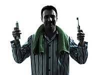 one man in pajamas tooth brushing silhouettes on white background