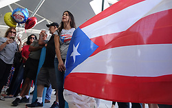 October 3, 2017 - Miami, Florida, US - Families of Caribbean hurricane evacuees who arrived on board the Royal Caribbean Adventure of the Seas, wait for their relatives at Port Everglades in Fprt Lauderdale. More than 3,000 people from Puerto Rico and the U.S. Virgin Islands were brought to Florida on board the cruise ship. (Credit Image: © Joe Cavaretta/TNS via ZUMA Wire)