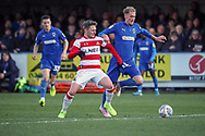 AFC Wimbledon midfielder Mitchell (Mitch) Pinnock (11) battles for possession during the EFL Sky Bet League 1 match between AFC Wimbledon and Doncaster Rovers at the Cherry Red Records Stadium, Kingston, England on 14 December 2019.