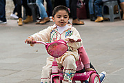 A young Mexican boy wears a costume as he rides his tricycle during the Day of the Dead festival October 31, 2017 in Patzcuaro, Michoacan, Mexico.