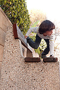 Playful young boy of 5 plays outdoors