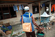 Darman (53 years) with his son Swanda (21 years) who was able to by himself a new motorcycle with the money he earned in the mine.  Bangka Island (Indonesia) is devastated by illegal tin mines. The demand for tin has increased due to its use in smart phones and tablets.<br /> <br /> Darman (53 ans) avec son fils Swanda (21 ans) qui a pu s'acheter une moto grosse cylindrée grâce à l'argent de l'étain. L'île de Bangka (Indonésie) est dévastée par des mines d'étain sauvages. la demande de l'étain a explosé à cause de son utilisation dans les smartphones et tablettes