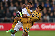 Dele Alli of Tottenham Hotspur gets to the ball ahead of Kyle Naughton of Swansea city .. Premier league match, Swansea city v Tottenham Hotspur  at the Liberty Stadium in Swansea, South Wales on Wednesday 5th April 2017.<br /> pic by Andrew Orchard, Andrew Orchard sports photography.