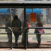 Bay Area Rapid Transit riders wait for the trolley at stops in San Francisco, CA.