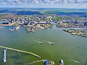 Nederland, Noord-Holland, Amsterdam, 07-05-2021; Houthavens, scheepvaartverkeer bij de vluchthaven, inclusief een drietal pontveren. IJveer vanuit NDSM-werf. Zicht op NDSM_werf, Johan van Hasselkanaal, Tuindorp Oostzaan en landelijk Noord, Waterland. Houthavens, shipping traffic at the airport, including three ferry boats. IJveer from NDSM wharf, Pontsteiger<br /> luchtfoto (toeslag op standaard tarieven);<br /> aerial photo (additional fee required)<br /> copyright © 2021 foto/photo Siebe Swart.
