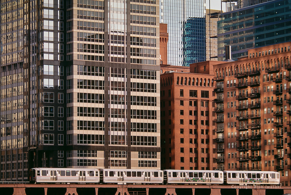 A Chicago Transit Authority train travels past office and residential buildings in downtown Chicago, Illinois
