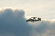 """A Northrop Grumman E2 Hawkeye, early warning aircraft with Carrier Airborne Early Warning Squadron 115 (VAW-115), also known as the """"Liberty Bells"""" flies over  Kanagawa, Japan. Tuesday January 17th 2017"""