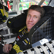 Sprint Cup Series driver Carl Edwards (19) smiles in his car during the 57th Annual NASCAR Coke Zero 400 practice session at Daytona International Speedway on Friday, July 3, 2015 in Daytona Beach, Florida.  (AP Photo/Alex Menendez)