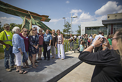 August 1, 2017 - Minneapolis, MN, USA - A group of survivors of the I-35W bridge collapse posed for a picture with Lt. Kim Lund, who has worked with many survivors and families over the last ten years, at a dedication for a piece of the wreckage displayed at the Emergency Operations Center as a reminder of the first responders' dedication and service on the day of the I-35W bridge collapse ten years ago today in Minneapolis, Minn., on August 1, 2017.   ] RENEE JONES SCHNEIDER Â¥ renee.jones@startribune.com (Credit Image: © Renee Jones Schneider/Minneapolis Star Tribune via ZUMA Wire)