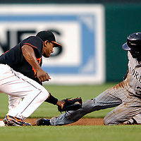 08 June 2007:   Colorado Rockies center fielder Willy Taveras (3) successfully steals second base in the 3rd inning as Baltimore Orioles shortstop Miguel Tejada (10) applies a late tag.  The Orioles defeated the Rockies 4-2 in interleague play at Camden Yards in Baltimore, MD.   ****For Editorial Use Only****