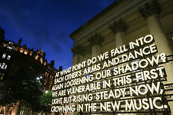 © Licensed to London News Pictures. 21/10/2021. Manchester, UK.  'Recovery Poems', a three-metre high light sculpture by artists Deanna Rodger and Robert Montgomery is displayed on the opening night of the 'Corridor of Light' festival in Manchester city centre. The new arts festival is designed as a celebration of the Oxford Road Corridor innovation district, an economically important area stretching south from St. Peter's Square which includes The University of Manchester, Manchester Metropolitan University, the Royal Northern College of Music and Manchester Science Park. Photo credit: Adam Vaughan/LNP