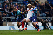 Dominic Gape of Wycombe Wanderers tackles Anton Walkes of Portsmouth during the EFL Sky Bet League 1 match between Wycombe Wanderers and Portsmouth at Adams Park, High Wycombe, England on 6 April 2019.