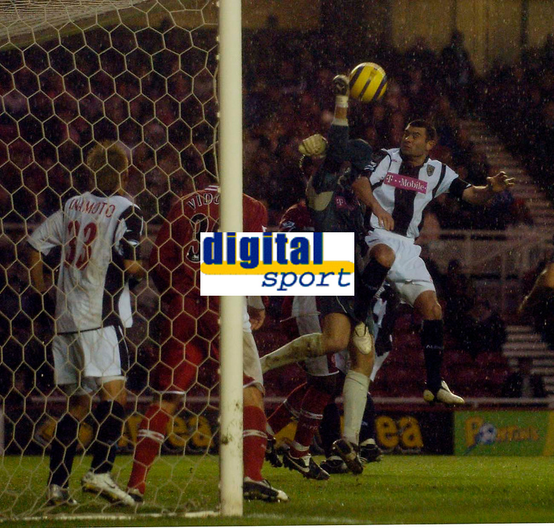 Photo: Jed Wee.<br /> Middlesbrough v West Bromwich Albion. The Barclays Premiership. 27/11/2005.<br /> <br /> West Brom goalkeeper Tomasz Kuszczak rises to punch the ball clear.