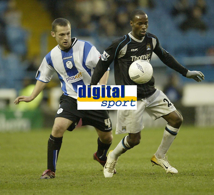 Photo: Aidan Ellis.<br /> Sheffield Wednesday v Manchester City. The FA Cup. 07/01/2007.<br /> City's DaMarcus Beasley holds off Wednesday's Kenny Lunt (L)