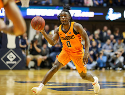 Feb 10, 2018; Morgantown, WV, USA; Oklahoma State Cowboys guard Brandon Averette (0) passes the ball during the first half against the West Virginia Mountaineers at WVU Coliseum. Mandatory Credit: Ben Queen-USA TODAY Sports