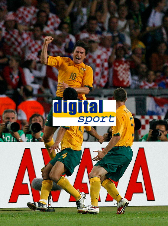 Photo: Glyn Thomas.<br />Croatia v Australia. Group F, FIFA World Cup 2006. 22/06/2006.<br /> Australia's Harry Kewell (top) celebrates scoring his side's second goal.