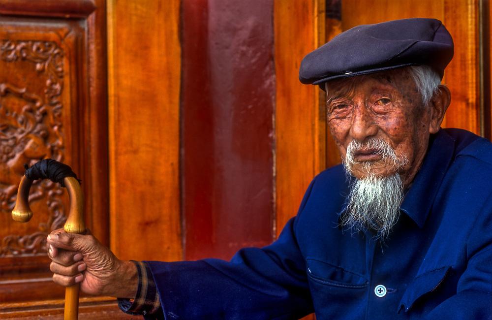 Bai tribespeople dress in traditional blue, Lijiang, Yunnan, China