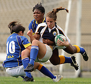 Bruin Ranger junior Jacqueline Johnson and a teammate tackle the ballcarrier during the Bruin Rangers' 42-0 victory over the UC San Diego Tritons on the intramural field at UCLA in Los Angeles on Saturday, Jan. 9, 2010.  The Brun Rangers would go on to have an undefeated season.