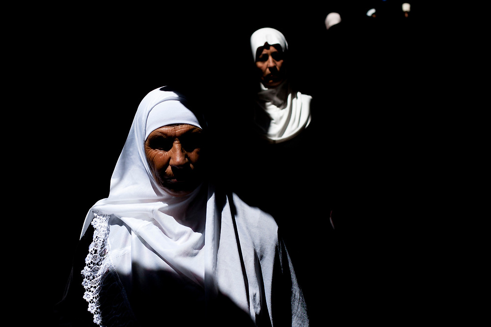 Muslim worshippers make their way through Jerusalem's Old City to attend prayers at the Al Aqsa Mosque on the last Friday of the Muslim holy month of Ramadan, September 3, 2010.