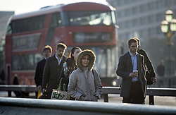 © Licensed to London News Pictures. 22/10/2019. London, UK. Commuters make their way across Westminster Bridge in London on a cold a bright morning. Photo credit: Ben Cawthra/LNP