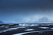 Melting snow on glacial alluvial plain by Skeidararjokull glacier in Vatnajokull National Park,  South Iceland