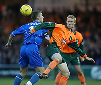 Photo. Aidan Ellis.<br /> Stockport County v Plymouth Argyle.<br /> Nationwide Division 2.<br /> 24/01/2004.<br /> Plymouth's Nathen Lowndes and Stockport's Rickie Lambert