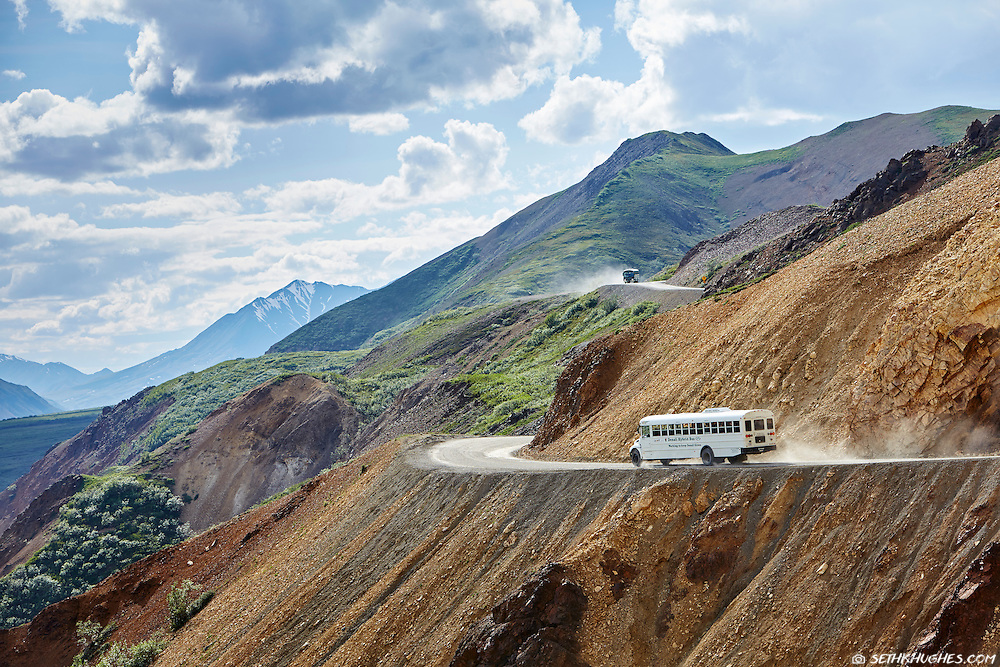 Tour buses negotiate the colorful Polychrome Pass near mile 46 on the Denali Park Road, Alaska.
