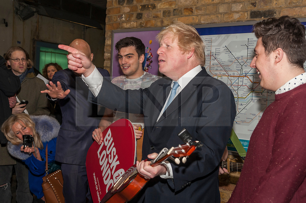 © Licensed to London News Pictures. 23/03/2015. London Bridge station, London UK. The Mayor of London, Boris Johnson, plays ukelele with London band, The Tailormade, to officially launch this year's Gigs busking competition and two brand new initiatives aimed at supporting and promoting busking and street performance in the capital and beyond.  The Tailormade are a three piece band from Ealing, made up of Jack Frimston, Matt Pickersgill and Aaron Murphy. Photo credit : Stephen Chung/LNP