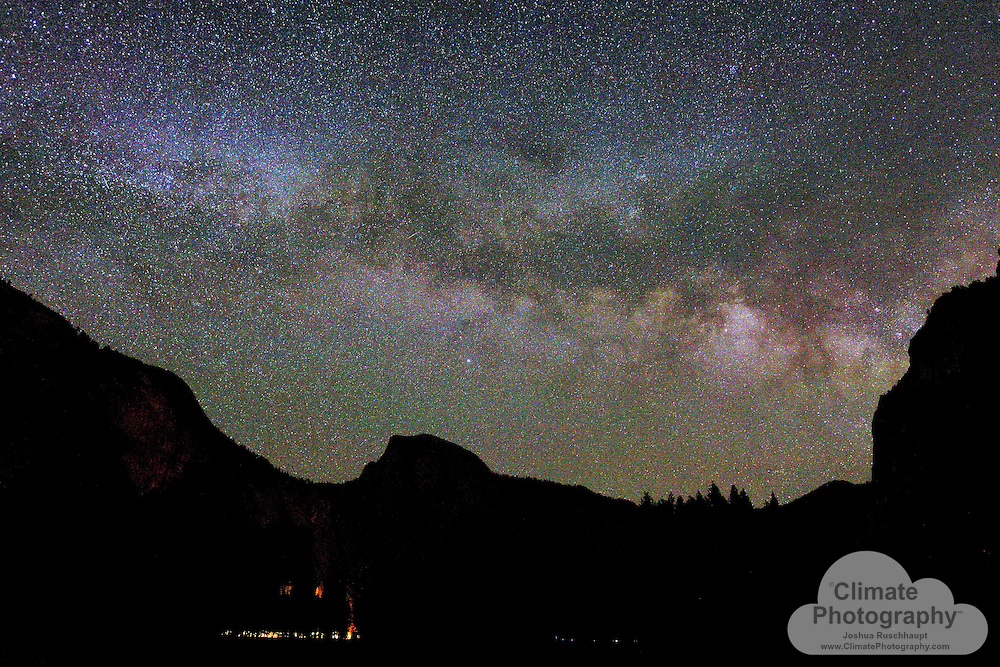 """Yosemite Valley, Yosemite National Park, CA, and Milky Way Galaxy. The moon was nearing the horizon in this image, so there is a moonlight that brightens the lower side of the Milky Way above Half Dome's silhouette.<br /> <br /> """"The clearest way into the Universe is through a forest wilderness."""" -John Muir, 1938"""