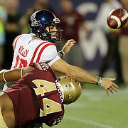 Mississippi Rebels quarterback Chad Kelly (10) gets tackled by Florida State Seminoles defensive end DeMarcus Walker (44) during an NCAA football game between the Ole Miss Rebels and the Florida State Seminoles at Camping World Stadium on September 5, 2016 in Orlando, Florida. (Alex Menendez via AP)