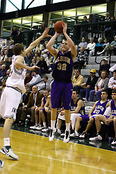 30 December 2006: Jim Cash shoots for 3 points. The Titans outscored the Britons by a score of 94-80. The Britons of Albion College visited the Illinois Wesleyan Titans at the Shirk Center in Bloomington Illinois.<br />