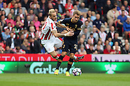 Christian Eriksen of Tottenham Hotspur (r) shields the ball from Marko Arnautovic of Stoke City. Premier league match, Stoke City v Tottenham Hotspur at the Bet365 Stadium in Stoke on Trent, Staffs on Saturday 10th September 2016.<br /> pic by Chris Stading, Andrew Orchard sports photography.