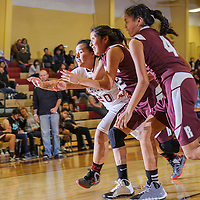 011714       Cable Hoover<br /> <br /> Rehoboth Lynx Bethany Cody (20) and Ramah Mustang Wynter Henio (32) chase a loose ball Friday at Rehoboth High School.