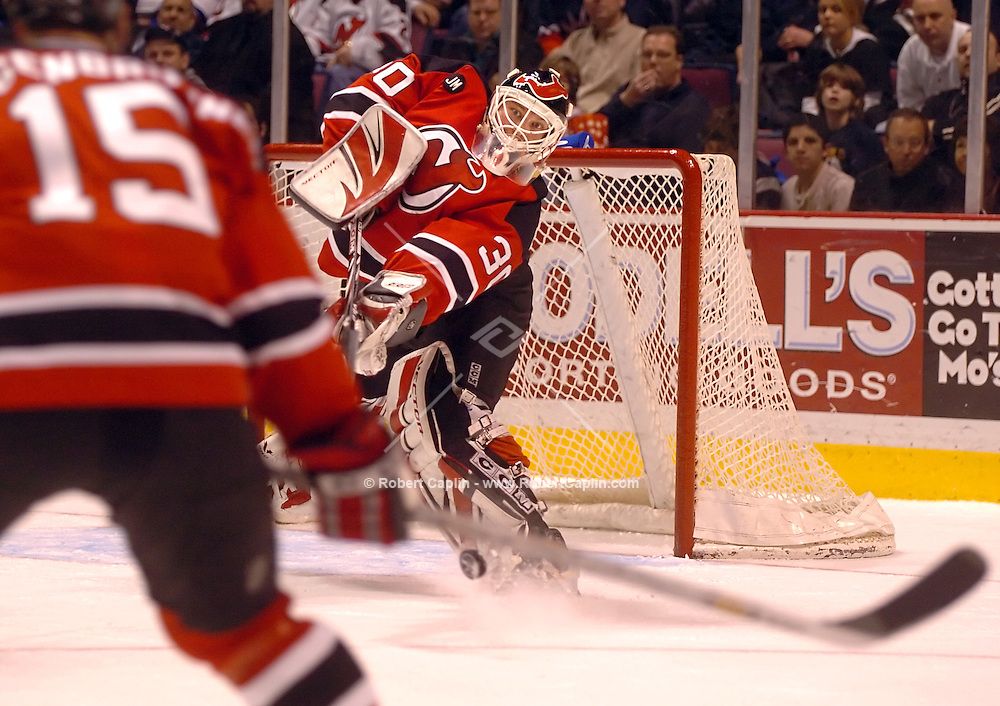 New Jersey Devils golaltender Martin Brodeur deflects a New York Ranger's slap-shot in the first period of their NHL game in East Rutherford, New jersey, March 4, 2006.
