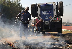 South Africa - Durban - 20 July 2020 - Police fire rubber bullet during a protest in Lamontville, Durban on the 20 July 2020 where the community is demanding their electricity be reinstated. Seven cars including a truck was burnt.<br /> Picture: Bongani Mbatha/African News Agency(ANA)